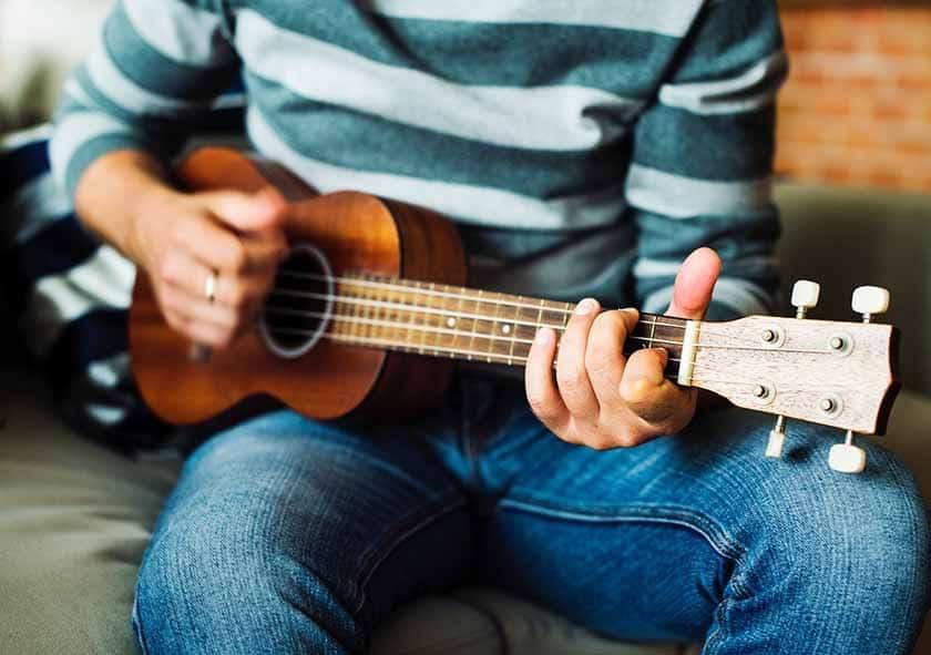 Performing with the ukulele while singing