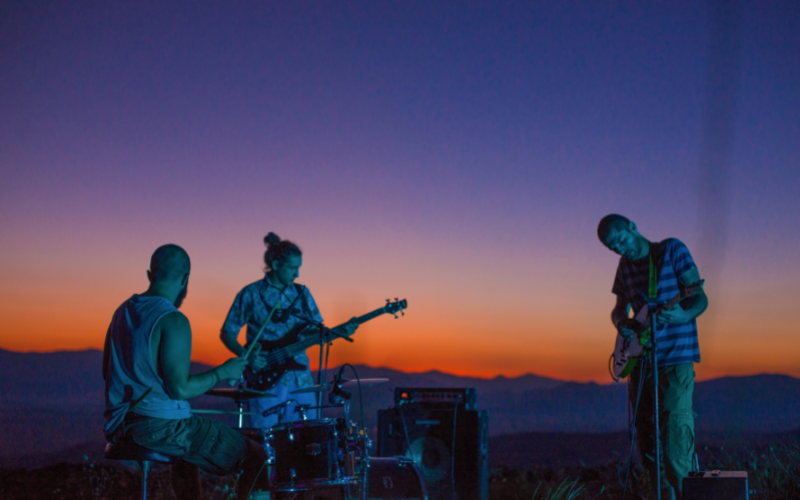 band members playing on the beach